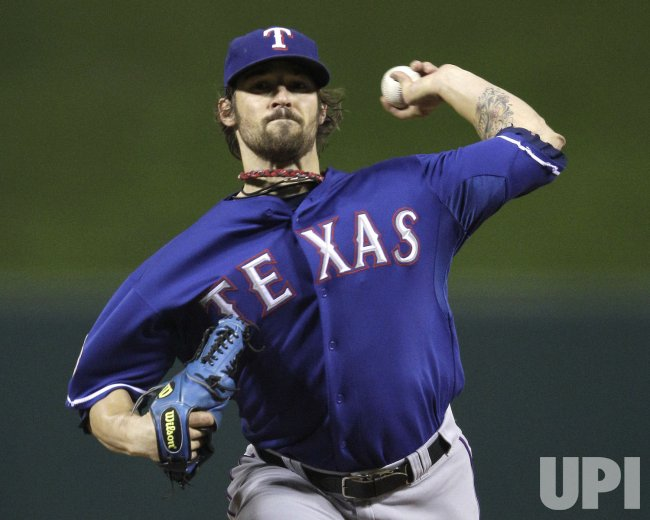 Rangers pitcher C.J. Wilson pitches against the Cardinals during game 1 of the World Series in St. Louis
