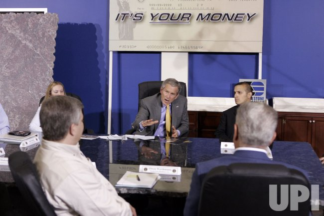 BUSH TOURS STONE DISTRIBUTOR, DISCUSSES TAXES AND ECONOMY