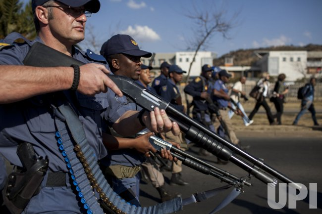Anti Obama protester's class with police outside the University of Johannesburg in South Africa
