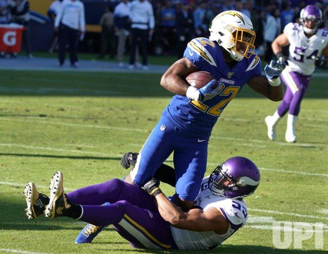 Minnesota Vikings linebacker Anthony Barr tackles Los Angeles Chargers Justin Jackson