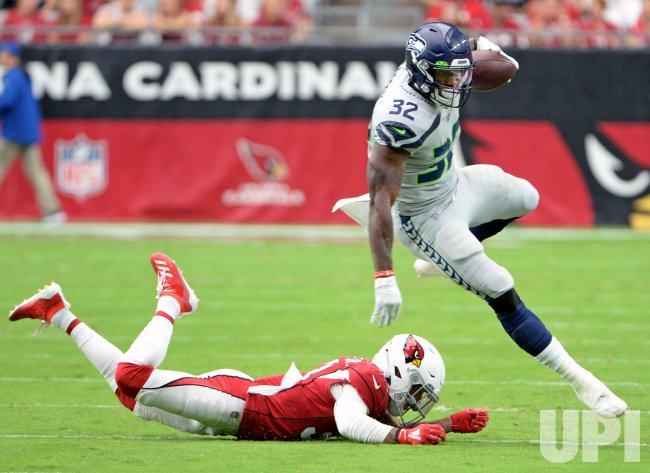 Seahawks' Carson leaps to get a first down