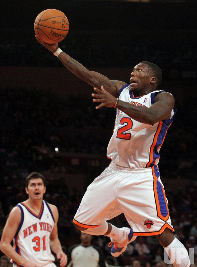 New York Knicks Nate Robinson drives to the basket in the second quarter against the Philadelphia 76ers at Madison Square Garden in New York