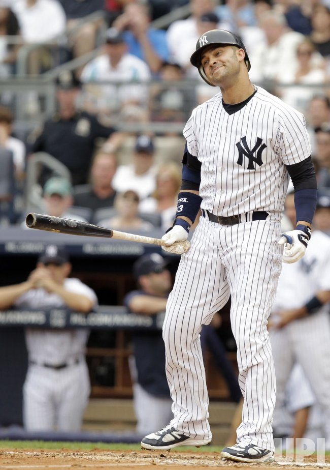 New York Yankees Nick Swisher reacts after striking out at Yankee Stadium in New York