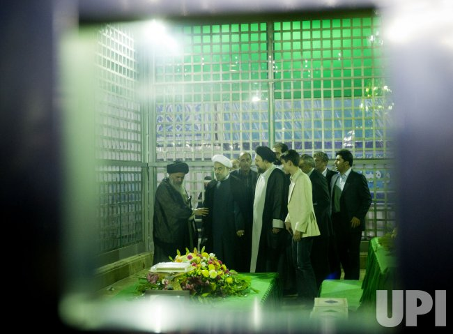 Iran's new president Hassan Rouhani pays a visit to the shrine Ayatollah Khomeini