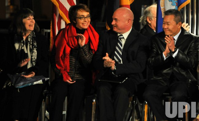 Giffords is the center of attention at a vigil in Tucson, Arizona.