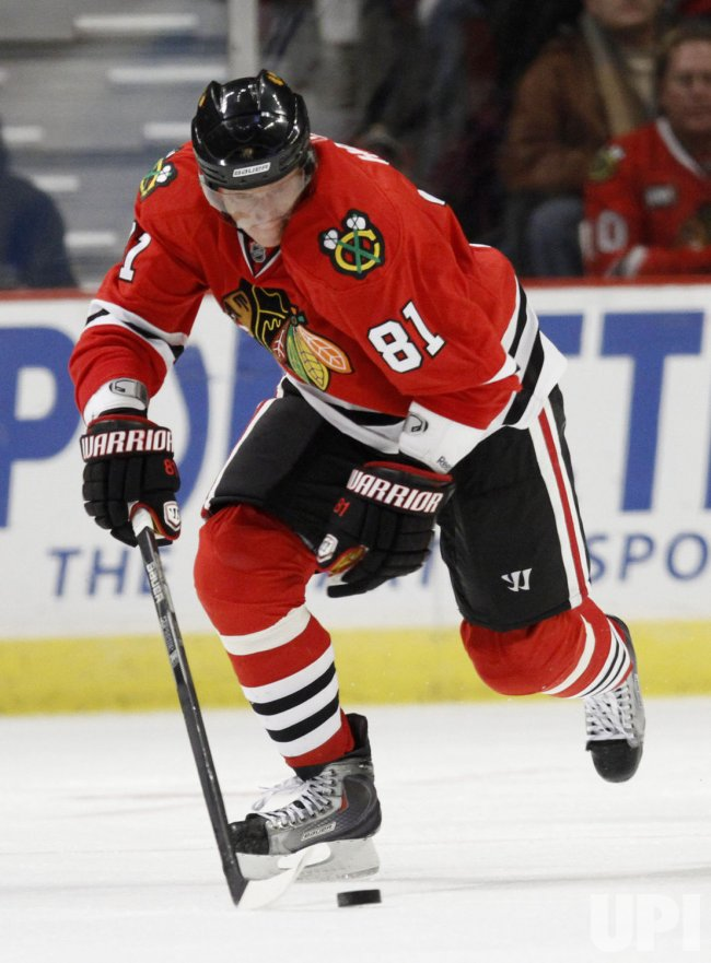 Blackhawks' Hossa handles the puck against the Rangers in Chicago