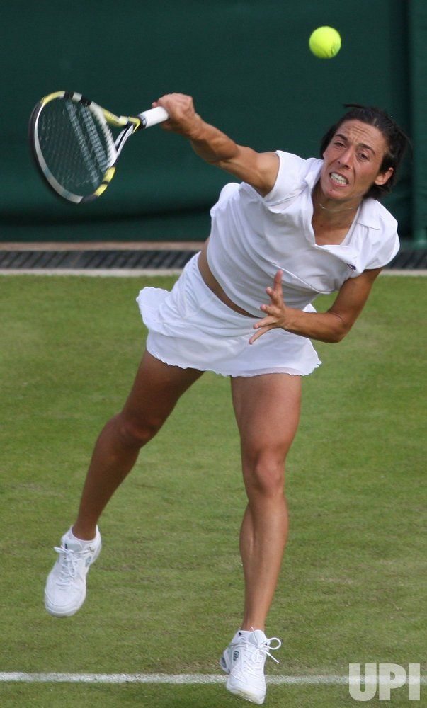 Francesca Schiavone serves the ball on the first day of Wimbledon.