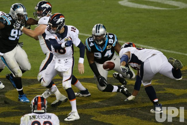 Panthers Ealy strips ball from Broncos Manning at Super Bowl 50