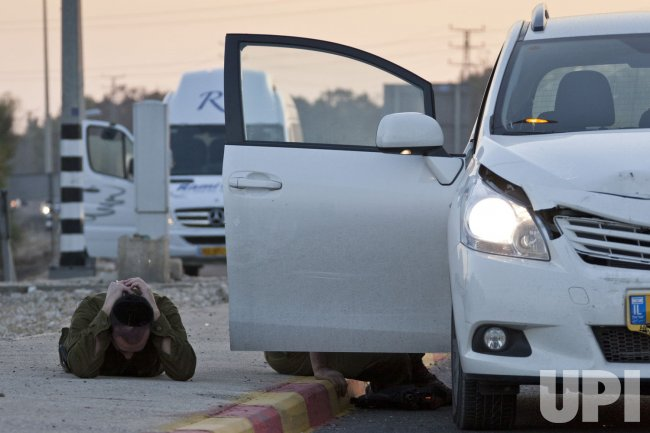 Israelis Take Cover From Rockets Fired From The Gaza Strip, Israel