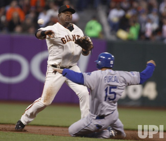 Giants Juan Uribe turns a double play against the Dodgers in San Francisco