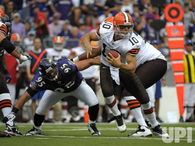Cleveland Browns' quarterback Brady Quinn scrambles against the Baltimore Ravens in Baltimore