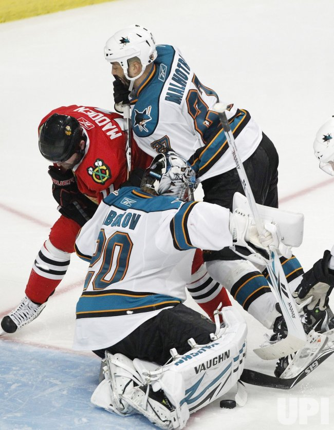 Blackhawks Madden tries to score past Sharks Nabokov in Chicago