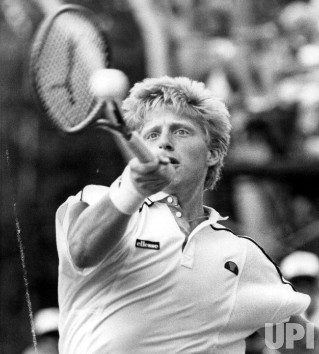 West Germany's Boris Becker hits a forehand to John McEnroe .