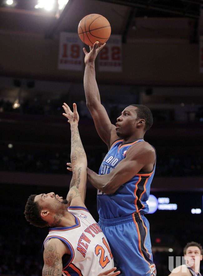 Oklahoma City Thunder Jeff Green drives into New York Knicks Wilson Chandler at Madison Square Garden in New York