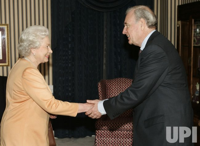 QUEEN ELIZABETH GREETS CANADA'S PRIME MINISTER PAUL MARTIN AFTER HER ARRIVAL IN CANADA