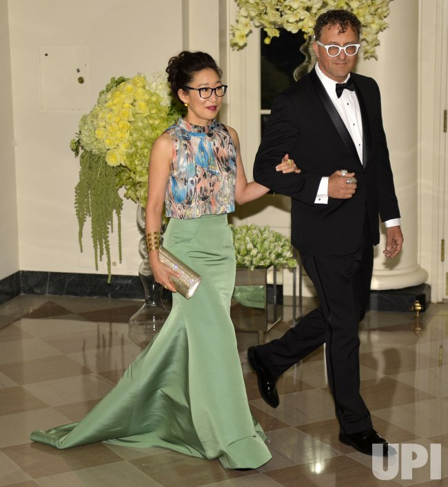 Sandra Oh And Lev Rukhin Arrive For State Dinner For