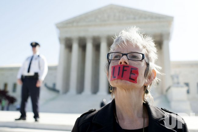 People protest in front of the Supreme Court in Washington