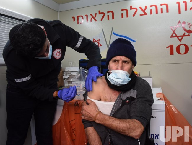 An Israeli Receives The Pfizer-Biotech Coronavirus Vaccine In Jerusalem