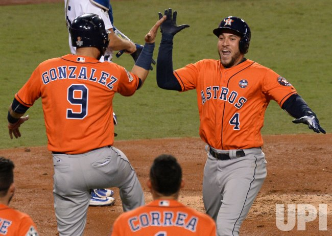 Astros Springer celebrates two-run homr in the World Series