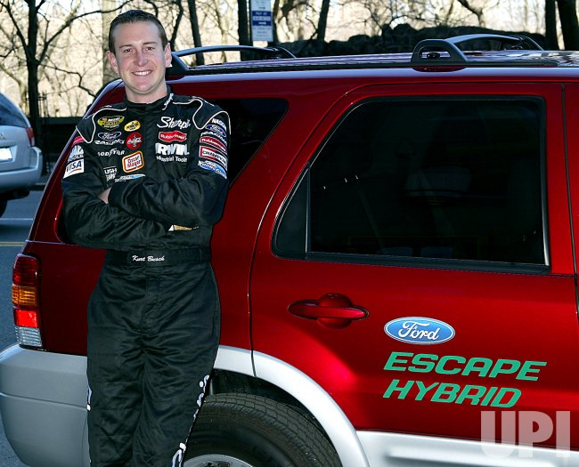 NASCAR DRIVER KURT BUSCH WITH NEW FORD HYBRID CAR