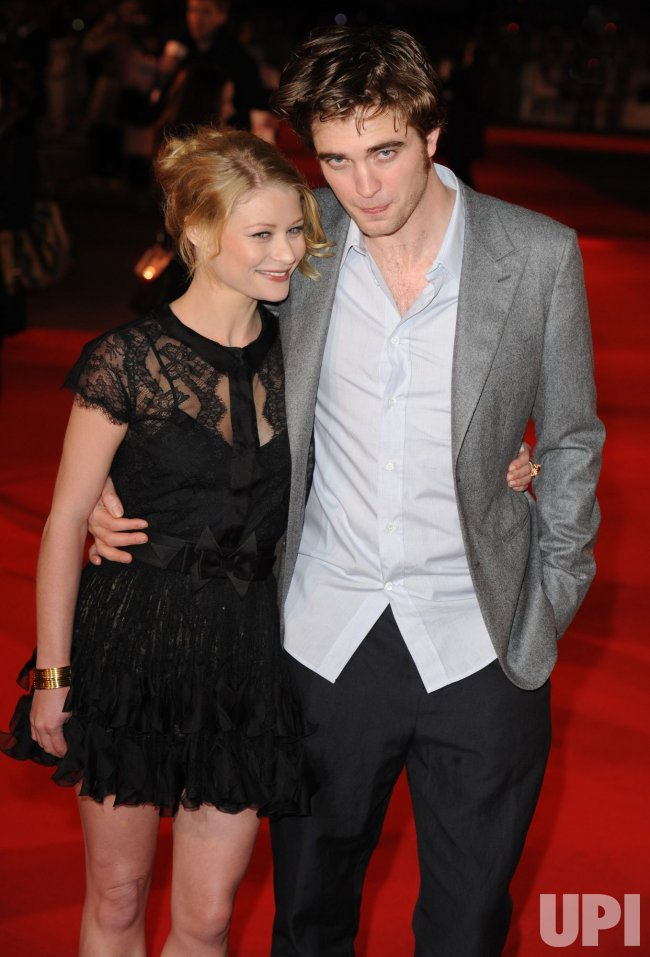"Robert Pattinson and Emilie de Ravin attend ""Remember Me"" premiere"
