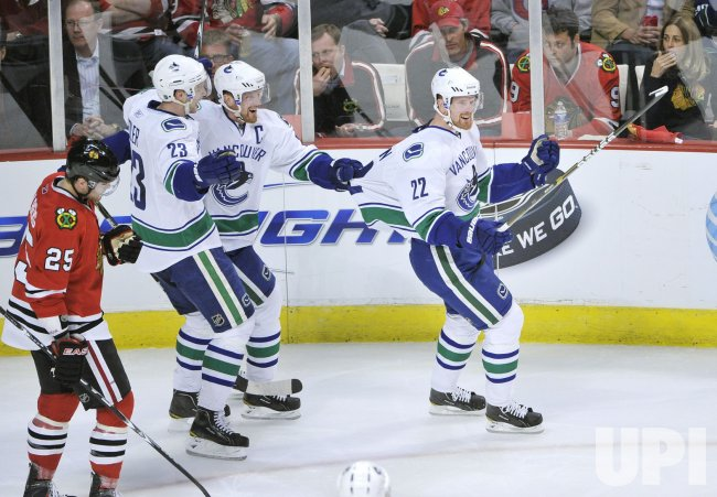Canucks Sedins, Edlerin celebrate goal against Blackhawks in Chicago