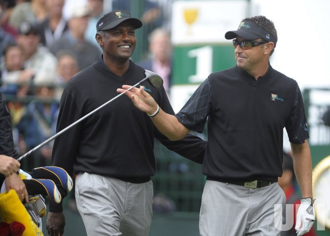 Robert Allenby and Vijay Singh walk together during the first round of the 2009 Presidents Cup in San Francisco