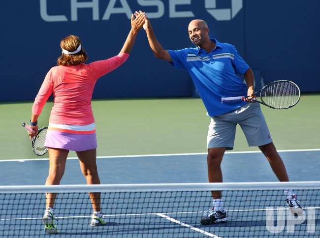 Gigi Fernandez and James Blake congratulate each other in Armstrong Stadium at the US Open