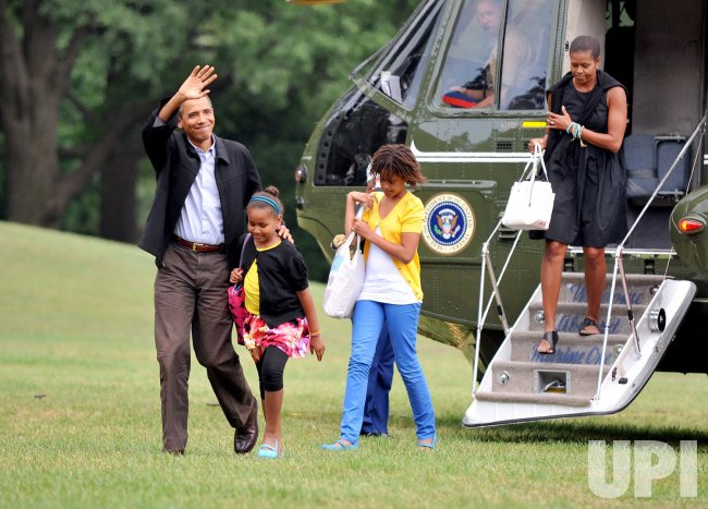 Obamas Return from Vacation