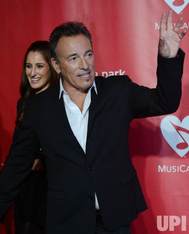 Bruce Springsteen arrives at 2013 MusiCares Person of the Year gala in Los Angeles
