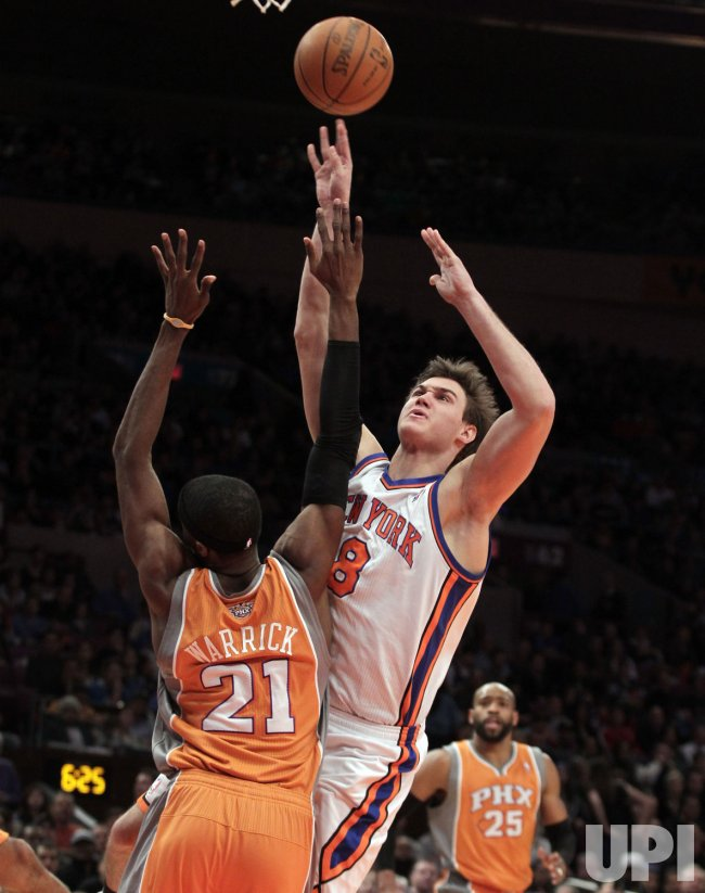 New York Knicks Danilo Gallinari shoots the ball over Phoenix Suns Hakim Warrick at Madison Square Garden in New York