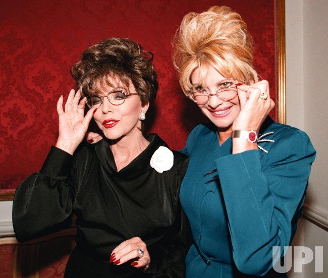 Joan Collins and Ivana Trump