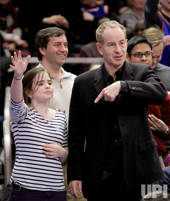 Tennis Legend John McEnroe tries to get a free shirt at Madison Square Garden in New York