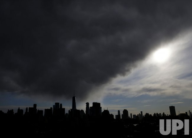 Storm Clouds and Sunlight Over Manhattan Skyline in New York