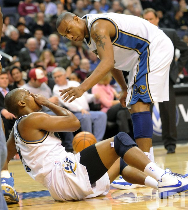 Wizards Butler checks on teammate Foye while playing the Magic in Washington