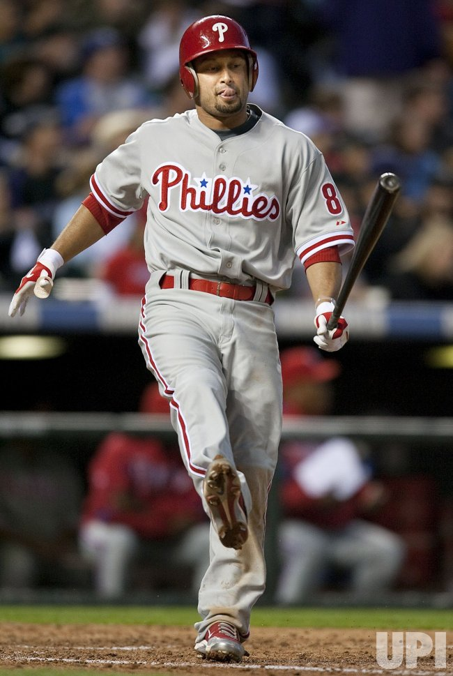 Phillies Victorino Reacts after a Rockies Pitch in Denver