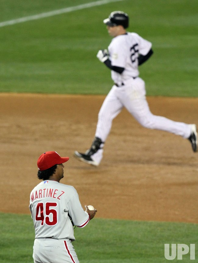 Philadelphia Phillies starting pitcher Pedro Martinez watches New York Yankees Mark Teixeira run the bases after Teixeira hits a solo homer in the fourth inning in game 2 of the World Series at Yankee Stadium in New York
