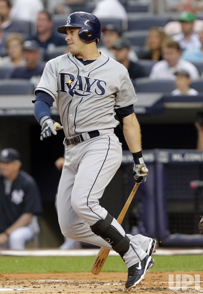 Tampa Bay Rays Evan Longoria hits an RBI single at Yankee Stadium in New York