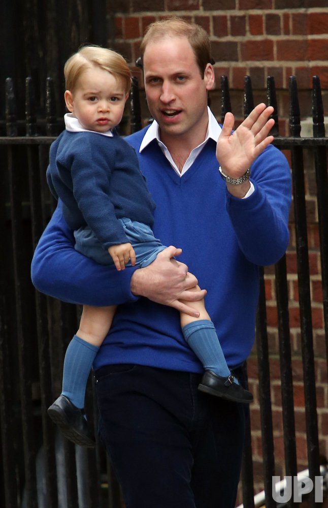 Prince William carries Prince George to see the new Royal baby.
