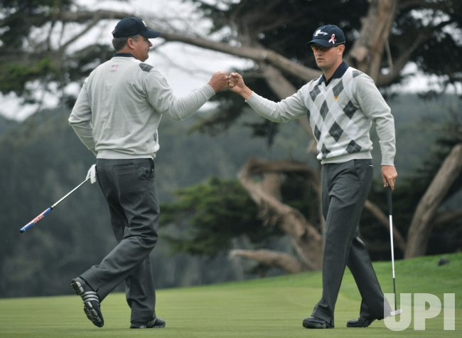 Kenny Perry and Zach Johnson celebrate during the third round of the 2009 Presidents Cup in San Francisco