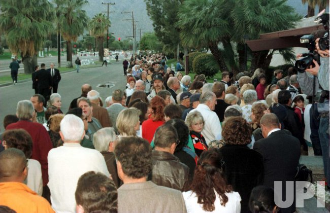 Hundreds of mourners file into St. Theresa's Catholic Church to pay respects to Sonny Bono