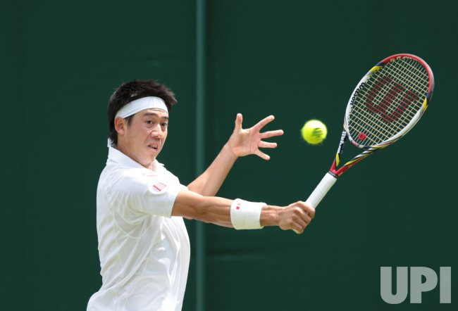 Kei Nishikori in action at 2013 Wimbledon Championships