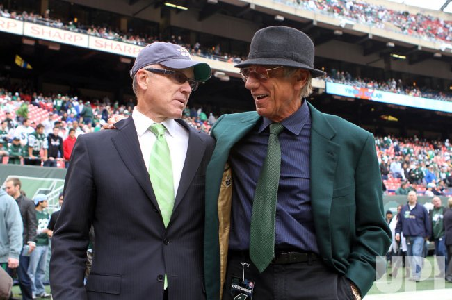 Woody Johnson and Joe Namath walk off the field together before the Miami Dolphins play the New York Jets in week 8 of the NFL season at Giants Stadium in East Rutherford, New Jersey