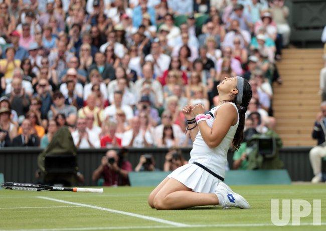 Marion Bartoli celebrates victory over Kirsten Flipkens