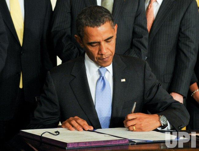 U.S. President Obama signs the Iran Sanctions Bill in Washington
