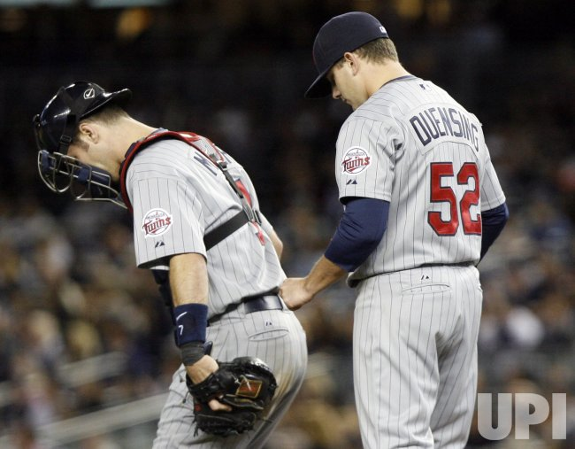 Minnesota Twins starting pitcher Brian Duensing and Joe Mauer look to the groiund against the New York Yankees in game 1 of the ALDS at Yankee Stadium in New York