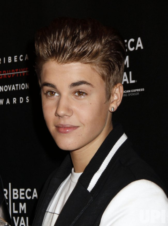 Justin Bieber arrives for the 2012 Tribeca Disruptive Innovation Awards in New York