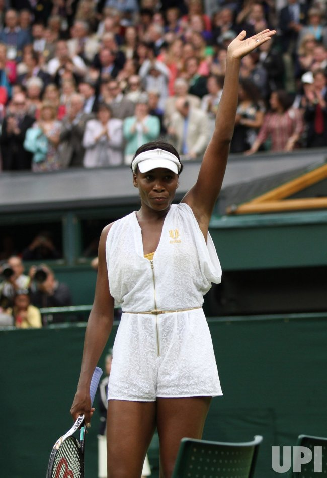 Venus Williams acknowledges crowd at Wimbledon.