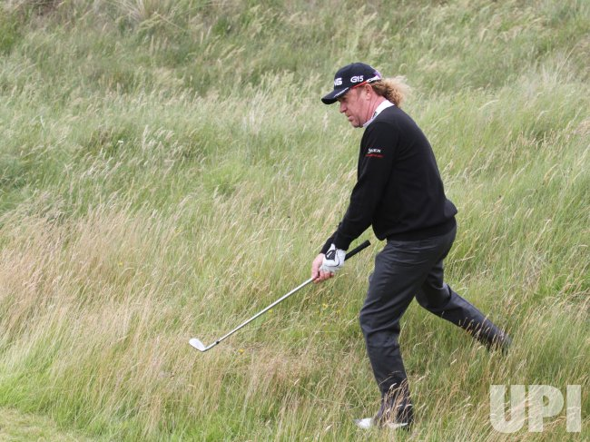Jimenez plays from the rough during practice day