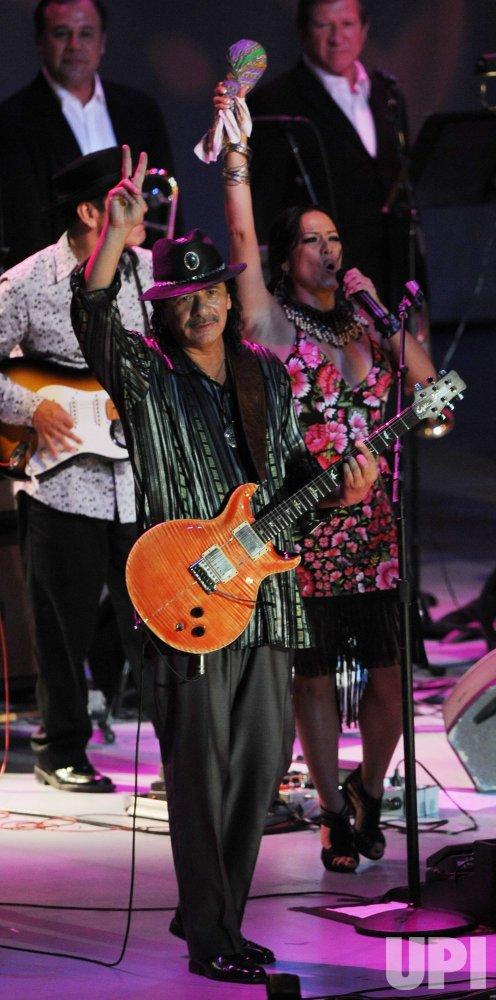 Carlos Santana and Lila Downs perform at Dolores Huerta's 80th birthday celebration in Los Angeles